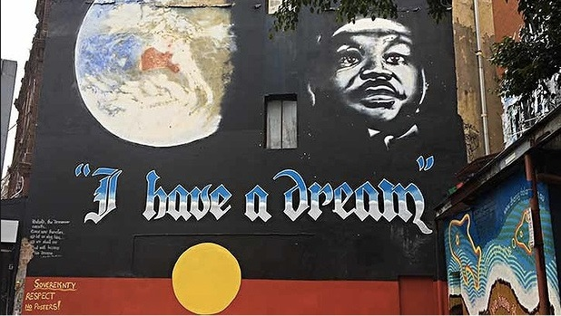 "STORY TIME: The ""I Have A Dream"" mural on King Street in Newtown was created during a weekend in August, 1991. The painters, Ms. Pryor and Andrew Aiken, asked to paint this twice and were denied permission, so they proceeded to do it anyway. Residents nearby called the police, and when talking to the police Ms. Pryor turned a stereotype into a tactic approval. ""I was a mild-mannered, middle-aged mother-of-three, and I said, 'Look at me - do I look like a graffiti artist?'"" Their purpose of painting this was to promote tolerance and equality. It has been heritage listed by the council in Australia which means it is no longer vulnerable for removal. ""We decided we'd go ahead and do this art work even if it didn't work or we got arrested. It was a statement and an expression of our philosophies. It represents the three themes from the 20th century, gender equality, environmental activism, and civil rights."" Amazing."
