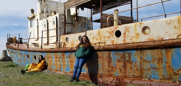 Arianna with an old boat along the Black Sea.